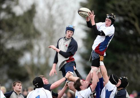 Carrickfergus College's Marc Gordon challenges Dalriada's Jamie Peoples in the line-out