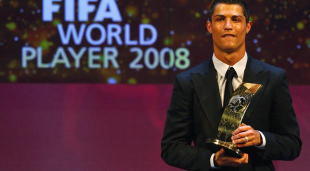 Cristiano Ronaldo of Portugal holds the trophy as he wins The FIFA World Player Of The Year 2008, at the Zurich Opera House on January 12, 2009