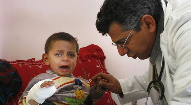 A Palestinian child is treated at Al-Najar hospital in Rafah on Tuesday