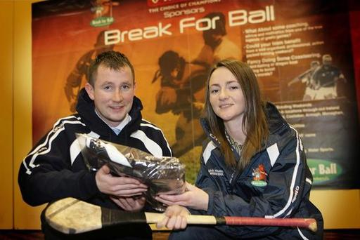 Former Antrim ace Kevin Madden brings Ulster's Allstar camogie ace Jane Adams up to speed on developments in his new sports bonding company 'Break for Ball'