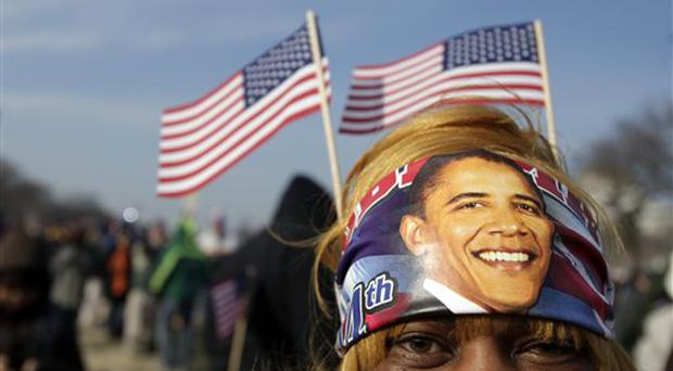 Shaine Martin of New Orleans, La., is photographed as she waits on National Mall for the inauguration of President-elect Barack Obama in Washington, Tuesday, Jan. 20, 2009. (AP Photo/Carolyn Kaster)