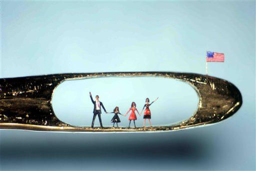 This undated image provided by UKFineArts Tuesday Jan. 20 2009, shows a micro sculpture by Willard Wigan showing U.S, President elect Barrack Obama and his family in the eye of a needle. Barack Obama will be inaugurated as the 44th U.S. president in Washington on Tuesday. (AP Photo/ UKFineArts,HO) ** NO SALES EDITORIAL USE ONLY **