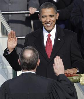 Barack Obama, left, takes the oath of office from Chief Justice John Roberts to become the 44th president of the United States at the U.S. Capitol in Washington, Tuesday, Jan. 20, 2009. (AP Photo/Jae C. Hong)
