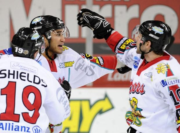Bobby Robins of the Belfast Giants celebrates with Colin Shields (left) and Paul Deniset (right) after scoring the first goal against of the Sheffield Steelers