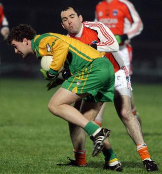 Donegal's Eamon McGee is stopped in his tracks by Armagh's Martin O'Rourke