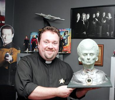 Father Ian Fee with his Star Trek collection.