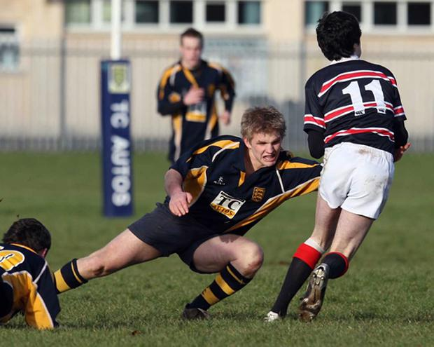 Omagh Academy vs Banbridge Academy. Omagh's Stewart McCain moves in to tackle Banbridge's Matthew Morrow.