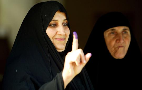 An Iraqi woman shows her inked finger after voting on January 31, 2009 in the Sadr city district in Baghdad, Iraq