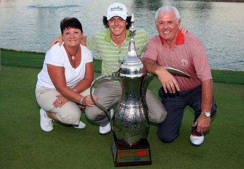 Rory McIlroy celebrating in Dubai with his parents Rosie and Gerry