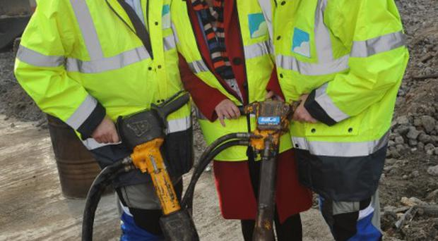 Social Development Minister Margaret Ritchie MLA, today officially cut the first sod to launch a new eco-friendly housing scheme in Newtownards. The development of 40 two bedroom apartments at Donaghadee Road, Newtownards by Connswater Homes and Sky Developments, is being piloted as the first social housing scheme to meet level 4 of the code for sustainable homes. From April 2008, all new social housing has been designed to level 3 of the code, in itself a significant step up from what went before. At level 3, CO2 emissions are improved by 25% whilst level 4 increases that by a further 19%. The code is designed to improve the sustainability of new homes and requires all new social housing to offer a reduced environmental impact, lower running costs and features that enhance health and well being. Pictured with Minister Ritchie at the launch today are Alan Johnston and Stephen McCready of Sky Developments. Photo by Simon Graham/Harrison Photography