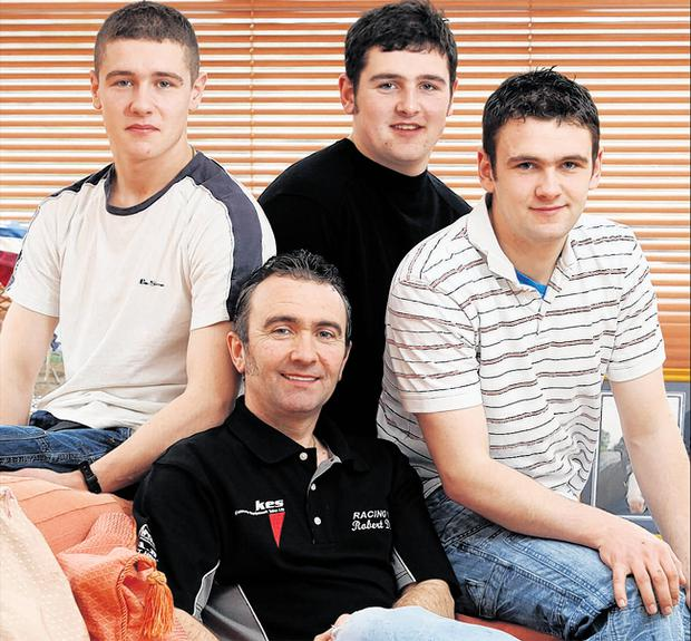 Robert Dunlop in a picture taken shortly before his death with (from left) sons Daniel, Michael and William