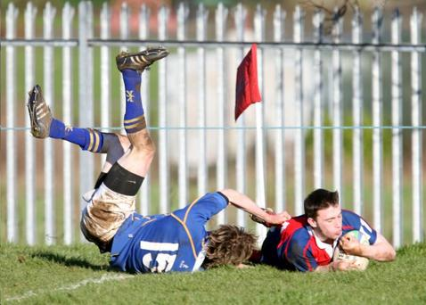 Nathan Laughlin goes over for a try in Ballyclare High's rout of Bangor Grammar