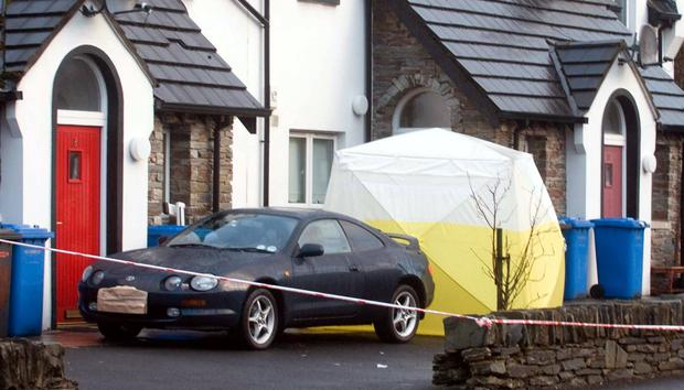 Murder probe: the scene at Woodland Avenue in Londonderry where a man was shot dead this morning