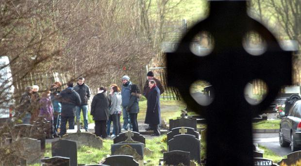 Relatives of buried babies and their friends at Milltown Cemetery
