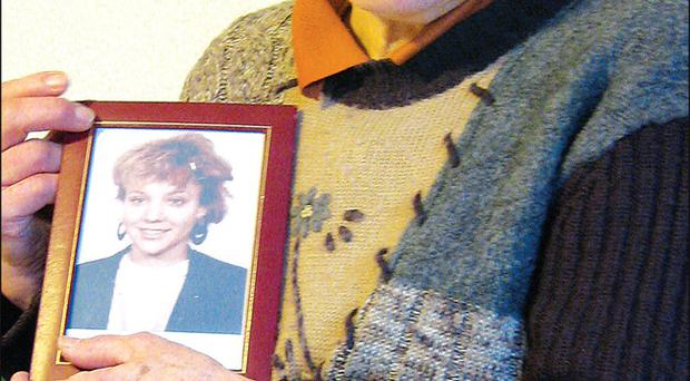 Almut Hauser reflects on her lost daughter as she holds a framed photo of Inga Maria