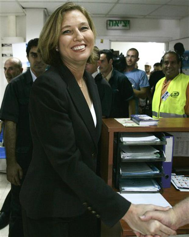 Israeli Foreign Minister and candidate for Kadima party leadership Tzipi Livni,left, is greeted by a supporter after casting her ballot in the Kadima primary in Tel Aviv, Israel, Wednesday, Sept. 17, 2008. TV exit polls say Livni has won a clear victory in the party primary election to replace Prime Minister Ehud Olmert. (AP Photo/Ariel Schalit)