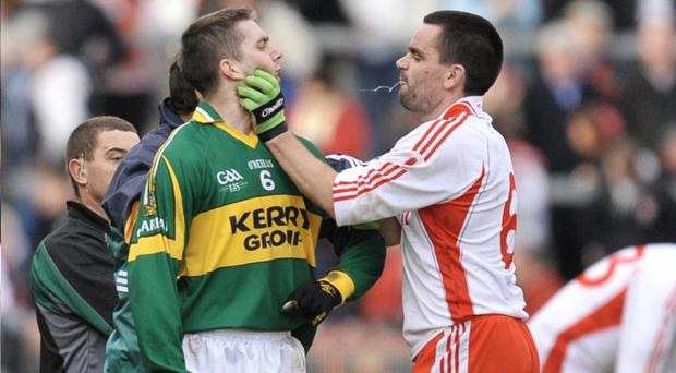 Tyrone's Ryan McMenamin man-handles Kerry's Marc O'Se during a heated National League encounter