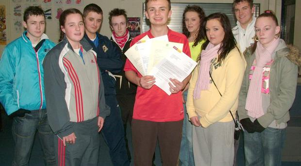 Jonathan McLarnon holds some of the correspondence received from MLAs, councillors and government departments by Finaghy Youth Club Road Safety Group during their campaign for traffic-calming measures on Finaghy Road South. Jonathan is pictured with fellow group members Ross Carlisle, Colleen Long, Dean Cartney, Gareth Carnaghan, Nicholas Surgeon, Chanel Curran, Sharlene Foster and Jordyn Reid.