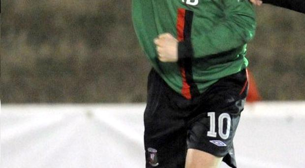Gary Hamilton gives a clenched fist salute to fans after putting Glentoran in front against Cliftonville last night