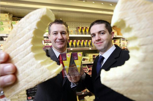 Cheesy grins all round as Michael McCambley (left), commercial buyer for Sainsbury's Northern Ireland, and Kevin McManus, sales manager for Fivemiletown Creamery sample the award-winning Ballyoak smoked brie