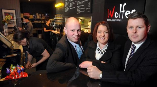 Viewing the new restaurant at Dundonald are (from left) Richard McKibben, from Osborne King, Olivia Hall, from Wolfe's Burger Connoisseurs and Mark Carron from Osborne King