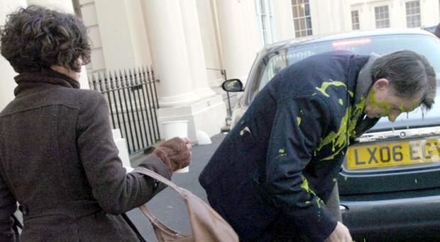 Business Secretary Lord Mandelson after a cup of green custard was thrown over him by environmentalist Leila Deen