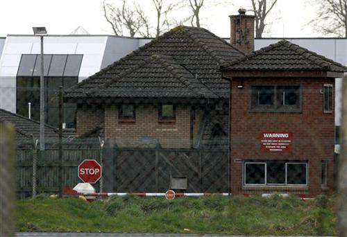 The front entrance to the Massereene army barracks in Antrim, west of Belfast, Northern Ireland, is seen Sunday, March, 8, 2009 after two British soldiers were shot to death and four other people wounded in a drive-by ambush that politicians blamed on IRA dissidents. Suspected IRA dissidents who opened fire on British soldiers and pizza delivery men outside an army base shot their victims again as they lay wounded on the ground, police said Sunday. Two soldiers died and four other people, including two men delivering pizzas, remained hospitalized with serious wounds following Saturday night's attack at the entrance to Massereene army barracks in Antrim, west of Belfast. (AP Photo/Peter Morrison)