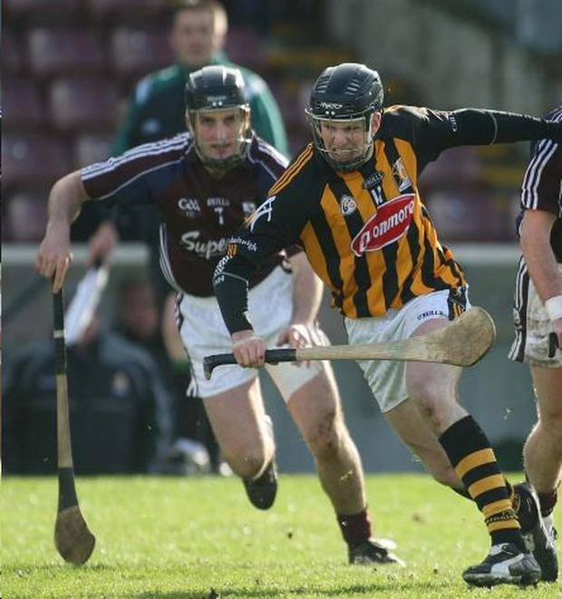 Michael Rice of Kilkenny is closed down by Shane Kavanagh