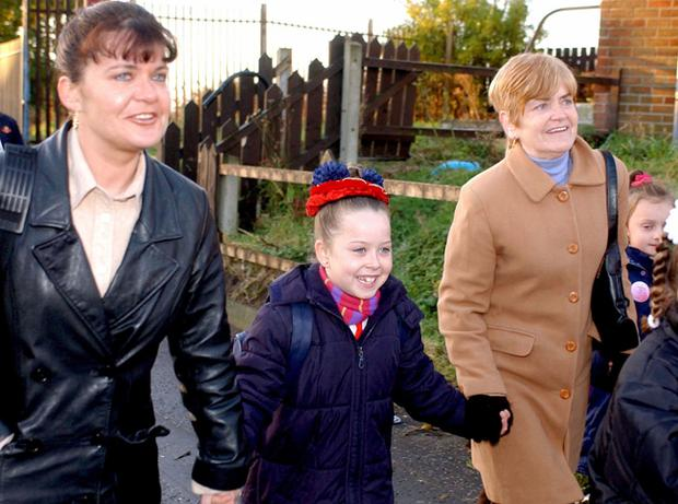 Holy Cross School, November 2001. Children laugh and sing as they make there way up the Ardoyne Road this morning after loyalist protests were suspended and things start to get back to normal for the first time since school term started in September of this year