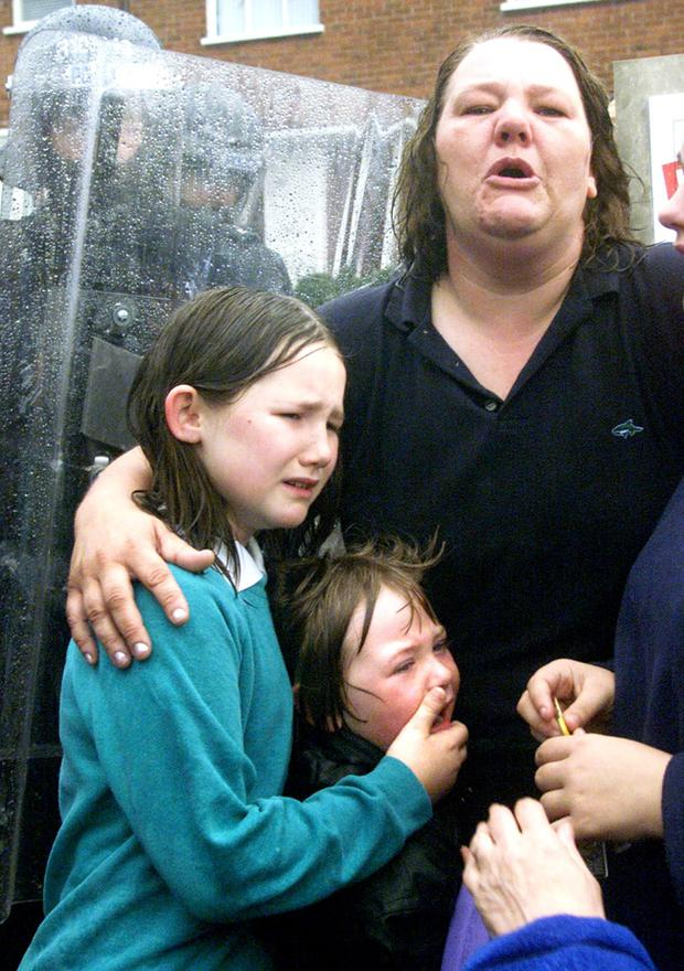 Protestant school children who were separated from their parents, scream for their mothers who were held behind armed police and army lines, before the catholic Holy Cross school children were brought to school in Ardoyne this morning.