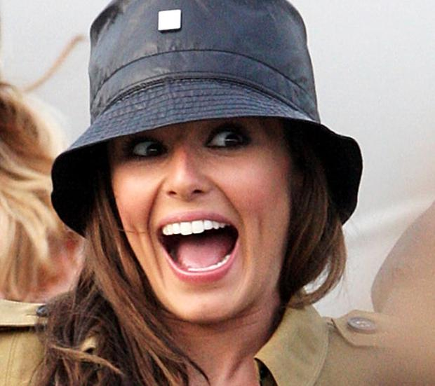 Cheryl Cole arrives back in the UK