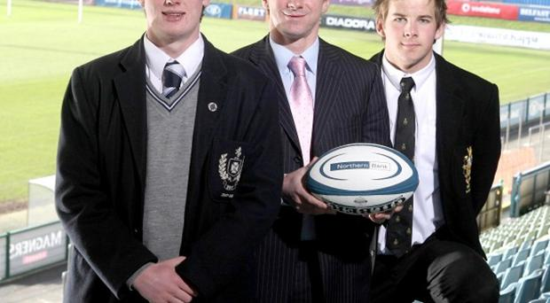 Bringing business to the rugby field are MCB captain Niall Annett, (left), Tyrone Howe from Schools' Cup sponsors Northern Bank, and RBAI captain Daryl Maxwell. The former Ireland international passed on his top tips for success to the young players ahead of tomorrow's final