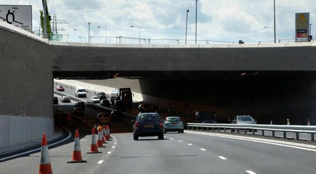 An 83-year-old woman has died in hospital following a road crash on the Westlink last month
