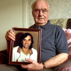 Richard (Dickie) Best with a picture of his son, footballer George Best pictured at his home in Belfast. October 2005