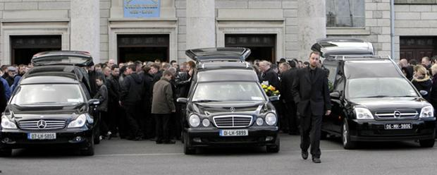 The funeral of James, 8, Anthony, 16, and Martin McDonagh, 21, at Our Lady of Lourdes Church in Drogheda. The brothers died in a blaze at the family home in Moneymore, Drogheda, Co Louth, last Monday.