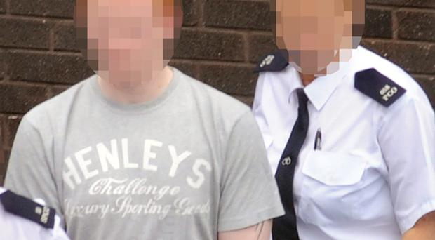 Prison officers leaving Lisburn Courthouse with the 17-year-old accused youth 24/04/09