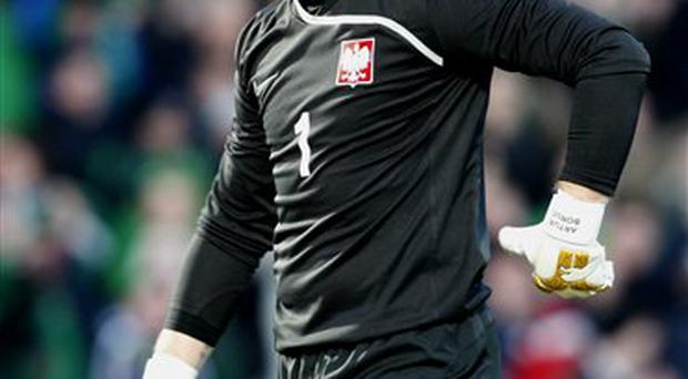 Poland's Artur Boruc looks dejected after scoring an own goal during their World Cup group 3 qualifying soccer match against Northern Ireland at Windsor Park, Belfast, Northern Ireland, Saturday, March, 28, 2009. (AP Photo/Peter Morrison)