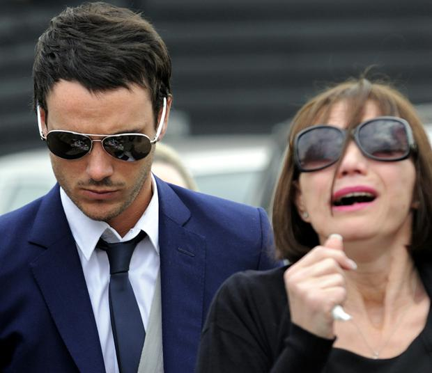 Jack Tweed (L) and Jackiey Budden leave the family home of television celebrity Jade Goody for her funeral service on April 4