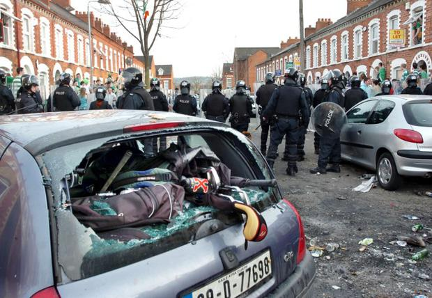 Alan Lewis - Photopress Belfast 17/3/2009..Serious rioting erupted this evening in the 'Holy Land' area of Belfast as police in full riot gear were called in to restore order as students and their friends 'celebrating' St Patrick's Day, ran amok in the Carmel Street area wrecking and attempting to set fire to cars. Oofficials from Queens University tried to defuse the situation but tensions remain high and with hundreds more people pouring into the area, there are fears of further violence. Police in riot gear with dogs, eventually cleared Carmel Street and there were clashes between them and students as they re-claimed the street.