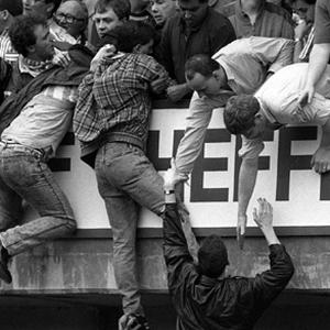 Liverpool fans at Hillsborough, trying to escape severe overcrowding