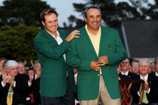 Trevor Immelman of South Africa congratulates Angel Cabrera of Argentina during the green jacket presentation after Cabrera defeated Kenny Perry on the second sudden death playoff hole to win the 2009 Masters Tournament at Augusta National Golf Club