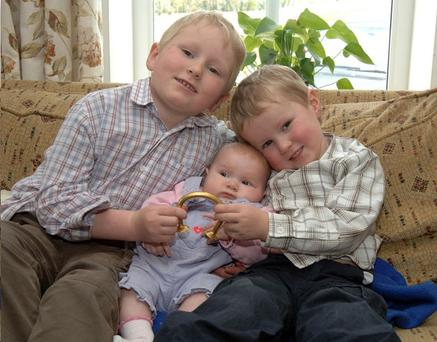 Garrison, baby Poppy and Timothy Sproule with the Bronze Age bracelet found on the family's farm
