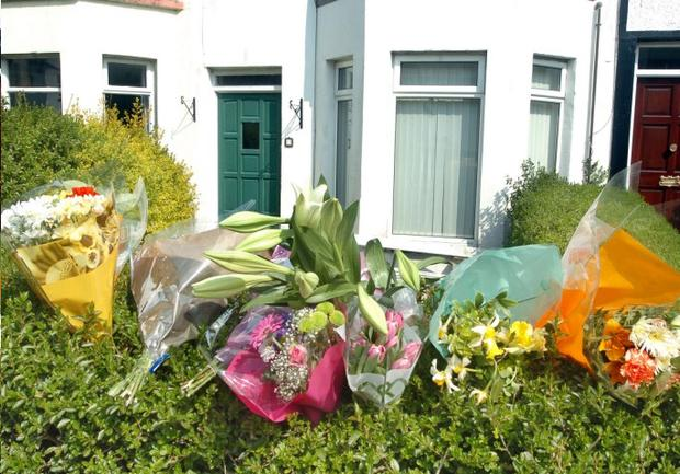 Flowers mark the scene where 21-year-old Katie Hughes was stabbed at an Easter house party at Park Avenue in Bangor on Tuesday