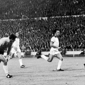 Benfica's Goalkeeper Jose Henrique (left) races back to his goal in a vain attempt to stop George Best (right) of Manchester United from scoring his team's second goal in the the European Cup final at Wembley, 29th May 1968. United eventually won 4-3 after extra time.