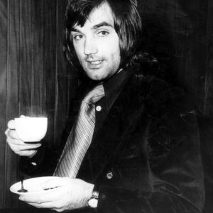 George Best relaxes with a cup of coffee as he waits for the action in Bulgaria to begin