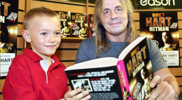 Carson Aiken (8) was first in the long queue of wrestling fans to meet Bret 'The Hitman' Hart at his book signing in Easons in Donegall Place