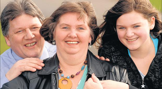 Recovery: Sharyn Mackay, whose cancer inexplicably disappeared, with her husband William and daughter Olivia (12)