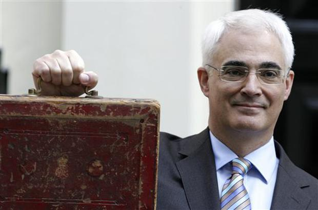 British Chancellor of the Exchequer Alistair Darling poses with his ministerial dispatch box as he leaves 11 Downing Street for the Houses of Parliament, to deliver the annual budget to the House of Commons, London, Wednesday, April 22, 2009. (AP Photo/Alastair Grant)