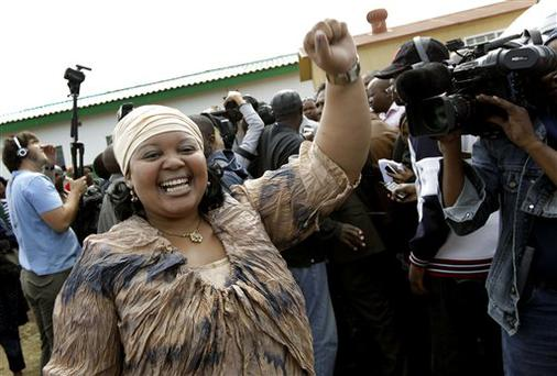 ANC president Jacob Zuma's youngest wife, Nompumelelo Ntuli, 34, raises her fist in victory after her husband cast his ballot for general elections at the Ntolwane primary school in the village of Kwanxamalala, South Africa, Wednesday April 22, 2009. South Africans are asking which of Zuma's two wives will be the official first lady. (AP Photo/Jerome Delay)