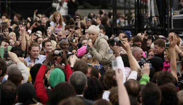 American singer Pink joins the crowd in Trafalgar Square for the T-Mobile flash mob singing event for their next television advert